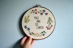 MADE TO ORDER: Please allow 3-4 weeks for your hoop to be recreated before shipping.  You Are So Loved  Add some happiness to your home with this spring inspired piece, that I am quite fond of! Would make a great gift for a loved one as well.   DETAILS: -This listing is for a 7 inch hoop -If you would prefer a different size, please send me a message! -Each hoop is backed with linen for a finished look  COLORS: -Please see the last photo for thread color options. -You may choose as many…