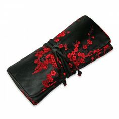 Each of our jewelry roll is hand-made with the highest quality silk brocade fabric. Designed for best functionality, keep rings, earrings, bracelets and other jewelry in this elegant case while you travel. Slightly padded to give extra protection.