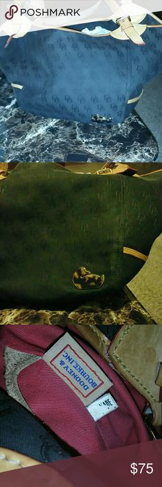 Dooney & Bourke Black Dooney & Bourke purse with brown leather trim duck on the front excellent condition no tears clean in the inside. Dooney & Bourke Bags Shoulder Bags