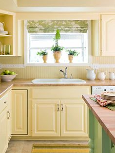 Fresh Citrus: Window Dressing- A light green and white Roman shade makes the greenhouse window above the sink the focal point of the room.