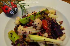 Hand-painted ladybug pebble looking out at home-made Leek quinoa gratin, (c) Ni Yan, February 2016