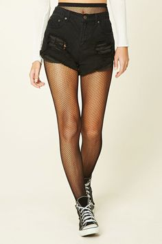 A pair of sheer lightweight knit fishnet tights with a scalloped ornate design and an elasticized waist.