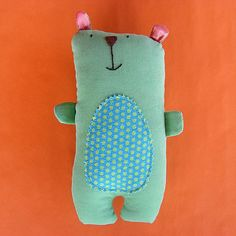 I like the simplicity of this bear...his shape and colors are very basic, but he's so huggable!