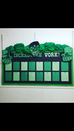 Incredible Hulk themed bulletin board to display student work The paper is stapled at each corner and the paper clip is just clipped at the top of the page, making it easy to change student worksheets