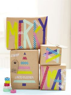 Christmas presents wrapped up in brown paper with personalised greetings using decorative tape - love!
