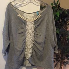 Free People Off the shoulder CUTE!!!! This is a size large. No tears or holes. Great shape.  Color is light gray.   This shirt is soooo cute w/an undershirt.  Jeans or shorts.  You can dress it up or down....very versatile.  ;)) Free People Tops