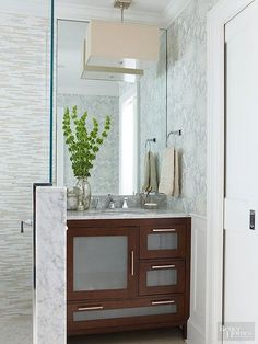 Door panels with glass inserts keep a wood vanity from looking too heavy.