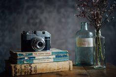still life photography, vintage camera and books