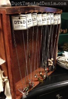 Old drawer I use to display short necklaces on my shelf at Paris Flea Market and other vintage markets. DIY jewelry decor idea. | DuctTapeAndDenim.com