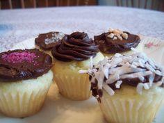 Mini cupcakes.  Vanilla with chocolate butter cream.