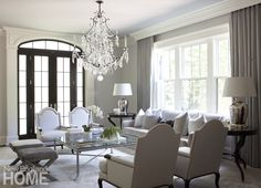 The living room's simple palette of creamy whites, soft silvers, and…  Beautiful chandelier adds to the otherwise simple elegance of this room.