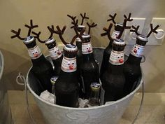 ugly Christmas sweater Party beer on ice - with antlers! #uglychristmassweaterparty get your sweater at www.myuglychristmassweater.com