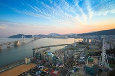 Busan's Gwangalli Beach at sunset. Image by JS`s favorite things / Getty - Provided by Lonely Planet