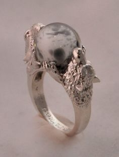 http://omniastudios.tumblr.com/post/126049649343/commissioned-custom-sterling-silver-ring-featuring