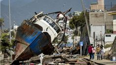 9/16/2015: A fishing boat that was ran aground by 15-ft tsunami waves while moored in the port of Coquimbo, some 445 km north of Santiago. At least 12 people died in the 8.3-m quake - the strongest in the world this year