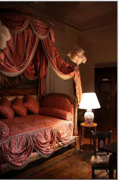 Another bed from an 18th century French Chateau. Obviously the lamp is modern but the rest . oooo la la