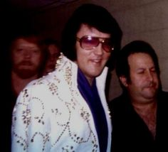 Elvis before his Tulsa show in march 1 1974 here with Joe Esposito and Red West. Elvis was wearing the gold vine suit .
