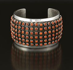 Cuff | Ernest Rangel (Navajo). Sterling silver and coral
