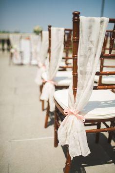 wedding aisle ideas -fabric drape chair decor with peach ribbon