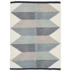 Designed in Denmark under the guidance of specialist local weavers, the Lagos's mix of geometric block colour and soft woven fibres mirrors perfectly the dichotomy of modern style and traditional craft present throughout Scandinavian design. Each rug is hand woven in India by master craftsmen using a blend of soft pure wool and flax.