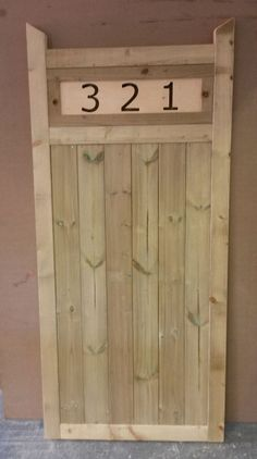 Wooden+Garden+Gate+Made+With+Cut+Out+House+Number+