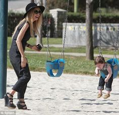 Baby steps: The stylist to the stars looked like she was struggling to get across the sand to take snaps of her young boy