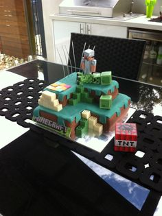 Minecraft cake butter cake with fondant topping and homemade choc blocks with eb games minecraft Steve and creeper