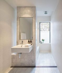 In love with the grey tile in this sleek modern bathroom. Modern Bathroom Design Ideas, Pictures, Remodel and Decor Long Narrow Bathroom, White Bathroom, Bathroom Interior, Modern Bathroom, Small Bathroom, Tile Bathrooms, Compact Bathroom, Bathroom Marble, Shower Bathroom