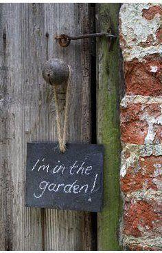 In the garden chalkboard sign