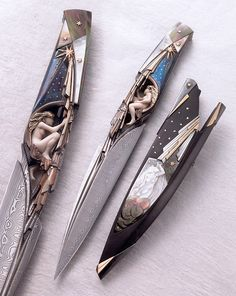 """The Luna"" by Arpad Bojtos - Blade: damasteel, Handle: mammoth ivory, titanium, gold, silver, mother of pearl  Sheath: buffalo horn, gold, silver, mother of pearl, sting-ray skin. The frame of the handle is made from titanium, inlaid with gold & silver, framing an inlaid carved figure of Luna made from mammoth ivory, the hair of the figure is made from gold. In the sheath is carved into the mother of pearl the figure of Southern Wind. Awarded""Best Art Knife"" at the Blade Show 2007 in…"