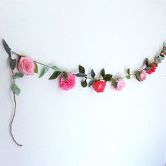 My friend from Fancy free finery at https://www.etsy.com/listing/227489624/felt-flower-garland-custom-colors