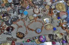 Wtw for 6/7  My work bench has a few finished bracelets. Mice adoring the moon blue moon face with gingerbread mount mice and chain. To the left is a vintage piece with the same chain. Other bits and combinations are occurring as I play with the parts.