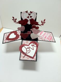 Card in a box, Valentines in a box Used Hearts a Flutter bundle, Occasions mini Love you to the Moon, Heart embosslit, Bird Punch, red glitter paper. All items are Stampin' Up!