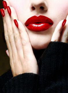 Red LIPS. Red FINGERNAILS. Makeup. Fashion. Female. Portrait. (Black turtleneck sweater.)