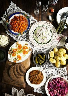 """Russian """"zakuski"""" (pronounced zah-kooski) which means little bites, better known as appetisers: Spiced Carrot Salad, Cucumber & Radish Salad with Dill Sour Cream Dressing, Hard-Boiled Eggs with Salmon Roe & Green Onions, Boiled Baby Potatoes with Dill & Butter, Poor Man's Caviar and Beetroot & Butter Bean Salad."""