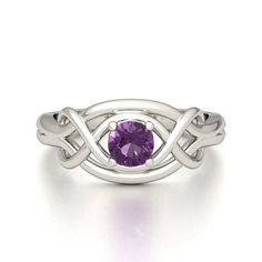 The Infinity Knot Ring. Stylish & Symbolic in Silver & Amethyst (Different color though)