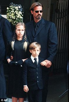 Allegra with her father Paul and brother Daniel at Gianni Versace's mass in Milan in 1997