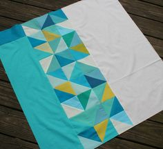 Welcome to Day 5 of the Festival of Half Square Triangles! Thanks, Megan, for inviting me to participate. I love half square triangles, and use them all of the time in quilt blocks. This tim…