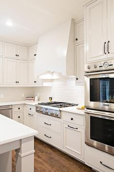 White Kitchen Hardware traditional kitchen features ivory cabinetry accented with oil