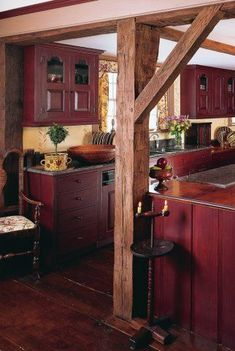 I like the dark red cabinets with the light walls. The exposed beams and dark wood floors are nice, too.