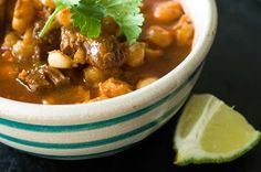 Red posole or pozole rojo is a tender pork stew loaded with chewy corn kernels in a fragrant red chile broth. Raw Food Recipes, Soup Recipes, Cooking Recipes, Freezer Recipes, Drink Recipes, Cooking Tips, Mexican Dinner Recipes, Mexican Dishes, Mexican Desserts