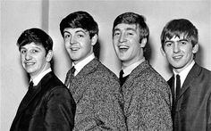 The Fab Four, the suits and the hair, they are so new at this.... its nice to see and know they all grew into their own skin... and hair.... i love this...
