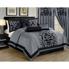 This elegant damask comforter set is crafted of high-quality 100-percent polyester for comfort and warmth. A black design on either pink or grey completes the look.