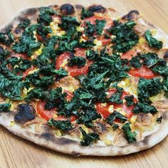 Grilled kale pizza with smoked Gruyère, sweet corn and chipotle chili oil