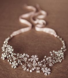 Hand twisted Halo with Silver Crystals and Rhinestone, and flower accents It is…