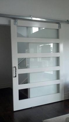 "10'0"" tall Style #100 SUPA Doors Style #500 w/ clear glass SUPA Doors 4'6"" wide Barn Slider"