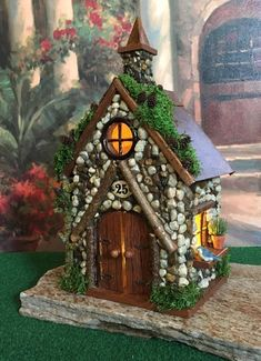 This whimsical little fairy house would be perfect in any fairy garden or placed in with a potted plant. Add a few Christmas trees and it would be perfect to use with your Christmas decorations. The doors to this house do open and lights are included. At The Healers Garden we are