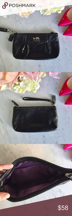 Black Coach Wristlet Black leather Coach wristlet with purple lining. Perfect for a night out when you wanna be hands free! Wear it as a wristlet or adjust the strap for a purse look. Never used! Coach Bags Clutches & Wristlets