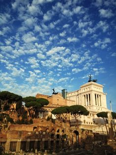 """Rome, the """"Wedding Cake"""" (Victor Emmanuel monument), pine trees, and a cloudy blue sky., Rome, province of Rome, Lazio region italy"""