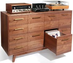 Pull-out drawers for record albums.  Husby would LOVE this!  And a place for his turn tables, too.